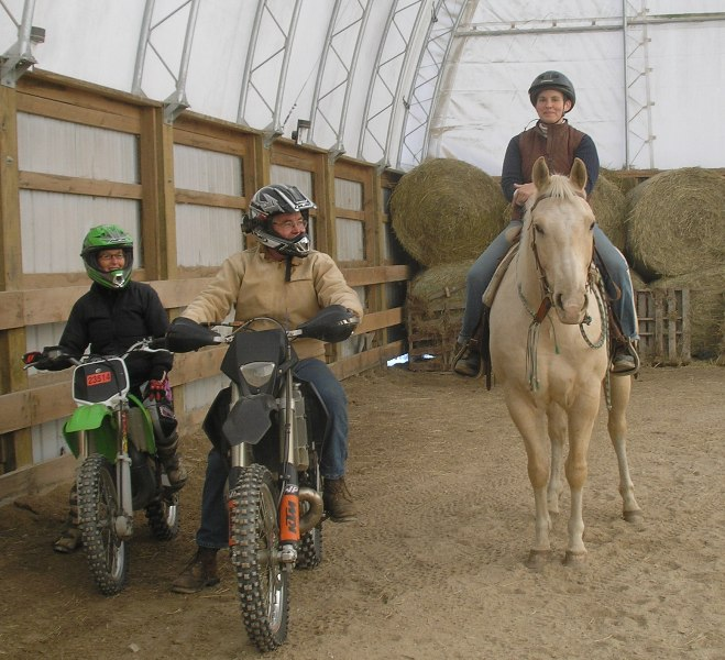 Bikes and horse pose after clinic
